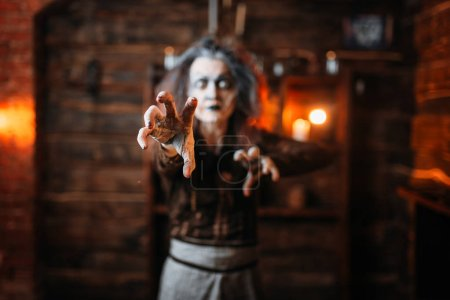 Photo for Scary witch hands out, front view, spiritual seance. Female foreteller calls the spirits, terrible fortune teller - Royalty Free Image