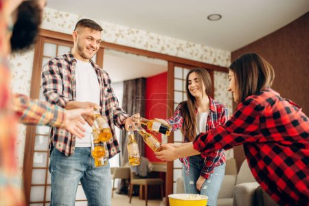 Photo for Friends with beer, pizza and popcorn at the home party. Good friendship, group of people leisures - Royalty Free Image