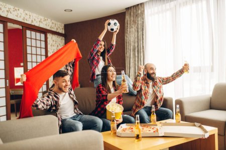 Photo for Smiling friends cheer for their favorite team, football fans. Group of people wathing tv broadcast at home. Cheerful company celebrate goal - Royalty Free Image