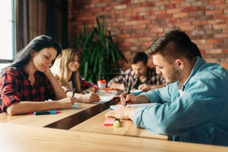 Photo for Group of highschool students prepares teamwork project. People studying together, university youth learning subject - Royalty Free Image