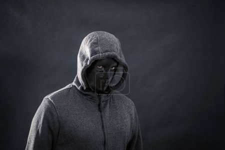 Photo for Hooded man with black mask in the dark - Royalty Free Image