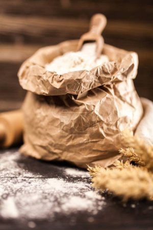 Photo for Bag of flour on wooden background - Royalty Free Image