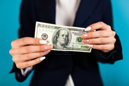 Photo for Woman holding a 100 dollar bill. - Royalty Free Image