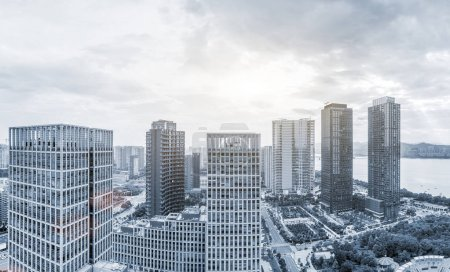 Photo for Skyscrapers of a modern city with overlooking perspective under sky - Royalty Free Image