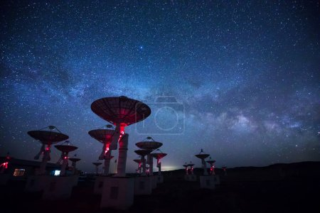 Radio Telescopes view at night with milky way in the sky