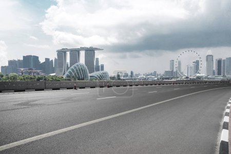 Photo for Empty road with city skyline - Royalty Free Image