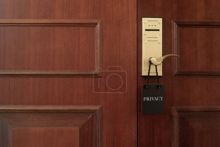 Closed door of hotel room with privacy sign