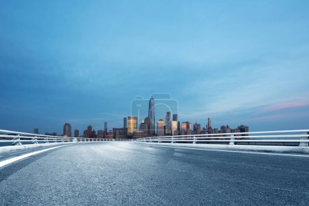 Photo for Asphalt street with modern city New York - Royalty Free Image