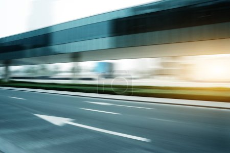 Photo for Empty asphalt highway through modern city - Royalty Free Image