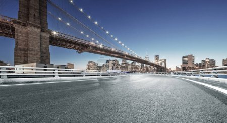 Photo for Asphalt highway with cityscape of Manhattan, New York - Royalty Free Image