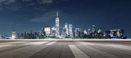 Photo for Empty ground with modern cityscape New York at night - Royalty Free Image