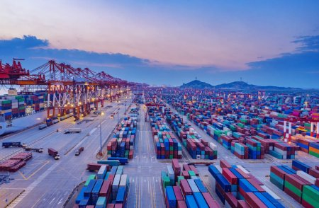 Photo for Container ship in export and import business and logistics. Shipping cargo to harbor by crane. Water transport International. Aerial view - Royalty Free Image