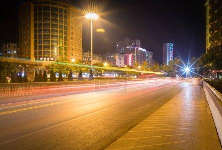 Photo for Light trails on city street, urban night scene - Royalty Free Image