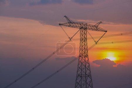 Photo for Power transmission pylon with sunset sky - Royalty Free Image