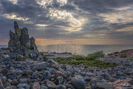 Rocky beach landscape at dusk. Hovs Hallar, Sweden.
