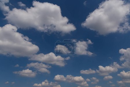 Photo for Cumulus clouds in a blue sky - Royalty Free Image