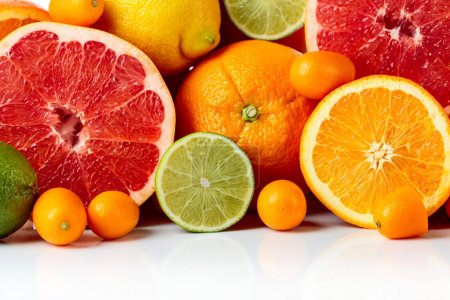 Photo for Close up of citrus fruits. Pieces of lemon, lime , tangerine , pink grapefruit and orange. - Royalty Free Image
