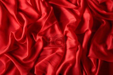Photo pour Tissu satin de soie rouge fond, vue du dessus . - image libre de droit