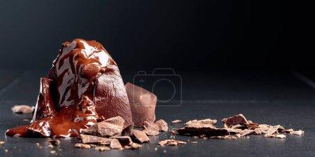Melting black chocolate.