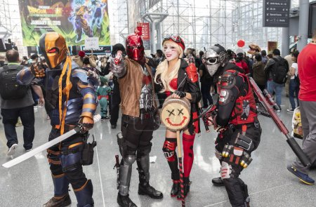 New York, NY, USA - October 5, 2018: Comic Con attendees pose in the costumes during Comic Con 2018 at The Jacob K. Javits Convention Center in New York City. The New York Comic Con is an annual New York City fan convention dedicated to comics