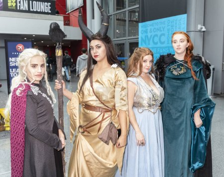 New York, USA - October 4, 2018: Comic Con attendees pose in the costumes during Comic Con 2018 at The Jacob K. Javits Convention Center in New York City. The New York Comic Con is an annual New York City fan convention dedicated to comics