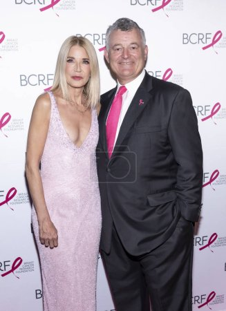 Photo for New York, NY, USA - May 15, 2019: Candace Bushnell and William P. Lauder attend the Breast Cancer Research Foundation 2019 Hot Pink Party at Park Avenue Armory, Manhattan - Royalty Free Image
