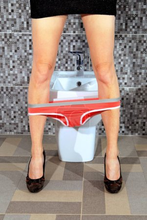 Photo for Part of the woman who stays near toilet bowl - Royalty Free Image