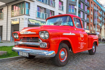 Gdansk, Poland - May 5, 2018: Red Chevrolet Apache pickup parked at the old town of Gdanks, Poland. Chevrolet Apache is a classic GMC car manufactured from 1958.