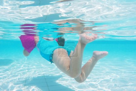 Little girl swimming in armbands on summer vacation