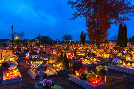 Photo for Gorna Grupa, Poland - November 1, 2018: Cemetary at night with colorful candles for All Saints Day in Poland. All Saints' Day is a solemnity celebrated on 1 November by the Catholic Church. - Royalty Free Image
