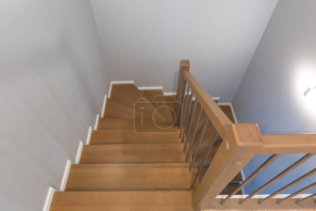 Photo for Staircase interior with new wooden steps - Royalty Free Image