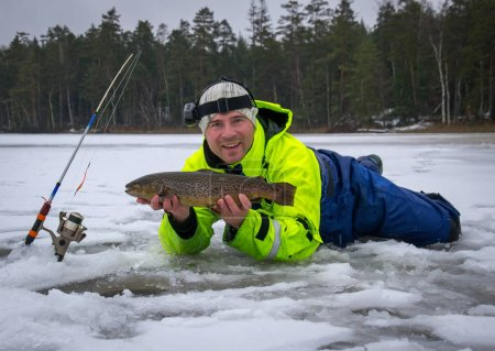 Angler with fresh caught sea trout