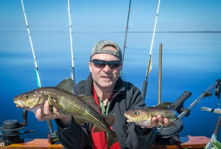 Happy angler with fishing trophy