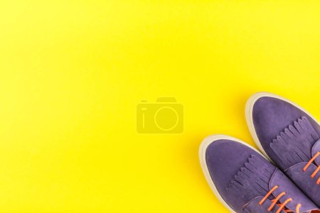 Photo for Flat lay of stylish suede shoes on bold yellow paper background with copy space. Overhead view of woman casual outfit. Trendy hipster look top view - Royalty Free Image