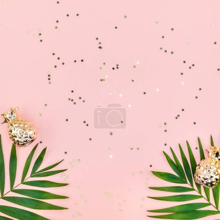 Photo for Creative flat lay top view of green tropical palm leaves millennial pink paper background with pineapples copy space. Minimal tropical palm leaf plants summer concept template for your text or design - Royalty Free Image