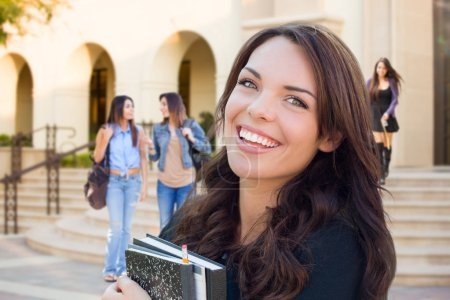 Smiling Mixed Race Young Girl with Books Walking On Campus.