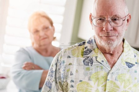 Photo for Senior Adult Couple in Dispute or Consoling in Kitchen of House. - Royalty Free Image
