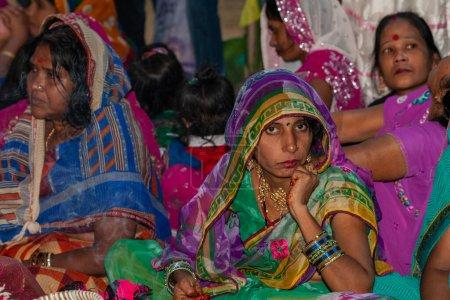 Photo for RAXAUL, INDIA - NOV 8: Unidentified Indian women celebrating Chhath on Nov 8, 2013 in Raxaul, Bihar state, India. - Royalty Free Image