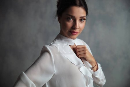 portrait of a happy elegant woman against studio background