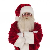portrait of santa claus wearing glasses standing with folded hands on white background