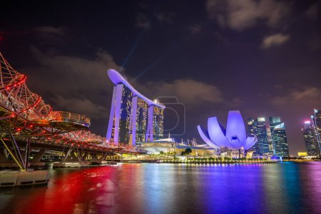 Photo for SINGAPORE CITY, SINGAPORE - MARCH 3, 2019: Spectra Light and Water Show Marina Bay Sand Casino Hotel Downtown Singapore - Royalty Free Image