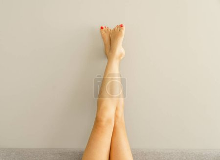 Photo for Image of female legs raised up against the wall - Royalty Free Image