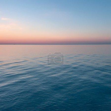 Colourful sky and calm sea at dusk