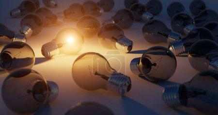 Photo pour Ampoule lumineuse éclairant d'autres ampoules avec lumière orange rendu 3D - image libre de droit