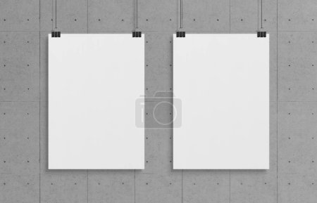 Photo for Two blank white poster hanging up with in front of concrete wall clips mockup - Royalty Free Image
