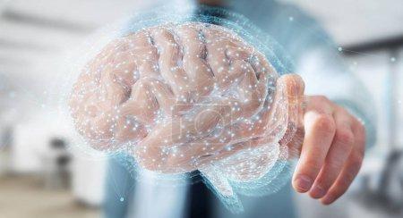Photo pour Homme d'affaires sur fond flou à l'aide à l'aide d'une projection 3d numérique d'un cerveau humain rendu 3d - image libre de droit