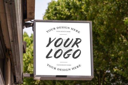 Store brand sign mockup in street