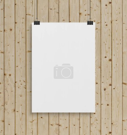 Blank white poster hanging up with in front of wood wall clips mockup