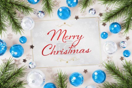 Photo for Christmas card greetings on white wood with blue baubles 3D rendering - Royalty Free Image