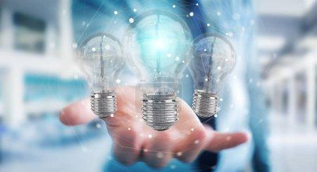 Photo pour Homme d'affaires sur fond flou reliant les ampoules modernes avec des connexions rendu 3D - image libre de droit